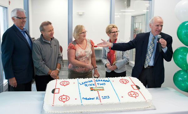 THEY KICK STARTED IT ALL: Peter and Cathy Clark donated $1 million in 2010 to help build a second ice rink at Leaside Memorial Community Gardens. On hand for the cake cutting are Don Valley West MP John Carmichael, left, and Ontario Premier Kathleen Wynne and Councillor John Parker, at right.