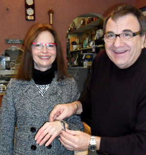Photis Philos presents Sylvia Crossley with her Movado watch.