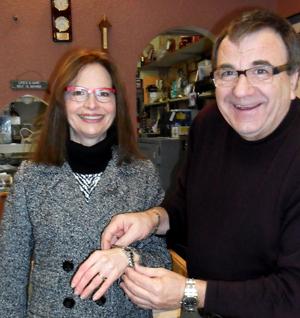 Photis Philos presents Sylvia Crossley with her Movado watch.
