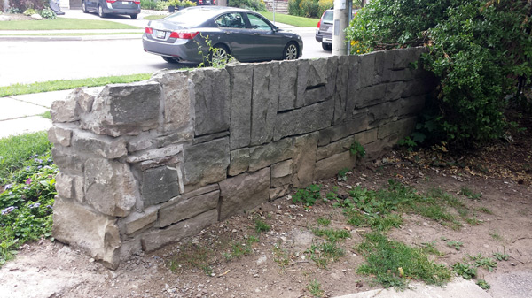 The stone wall cut back for heavy equipment