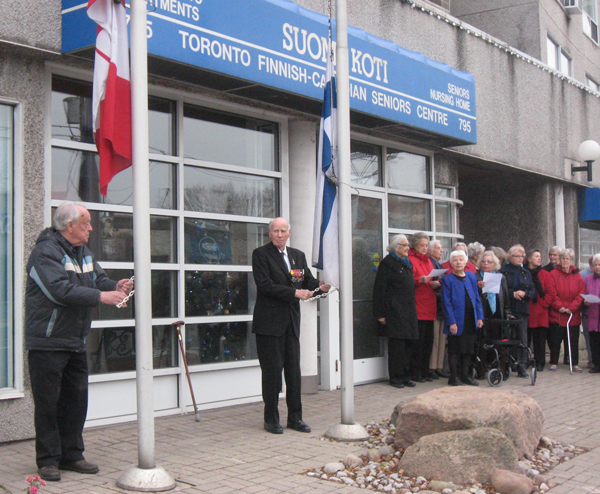 Finnish Canadian residents of the Suomi Koti Centre on Eglinton recently marked their independence from Russia on Dec. 6, 1917 by singing the Finnish national anthem and raising flags. The Maple Leaf was hoisted by 90-year-old Pauli Paavola while 97-year-old Veikko Kallio – who fought in the 1939 Winter War – raised the Finnish flag.