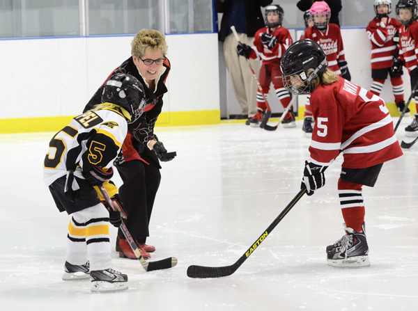 Premier Kathleen Wynne drops the first puck for the March Madness hockey tournament.