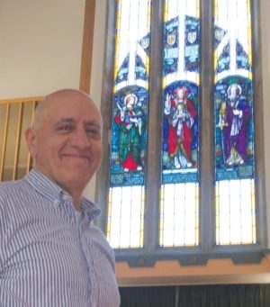 The Rev. Nick Athanasiadis of Leaside Presbyterian and the Memorial Window from the former Glebe church.