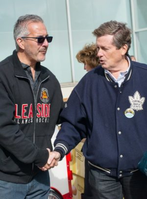 Picture of John Tory and Patrick Rocca shaking hands at apple fest