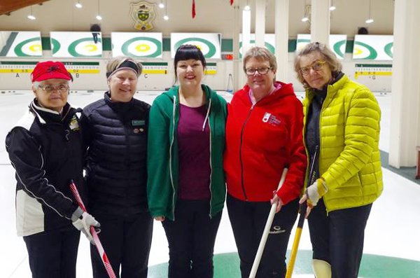 PIcture of Karli Vezina surrounded by her new curling mentors (Gail Ann Ferguson, Janet Macmillan, Paivi Liitela & Jane Burgess)