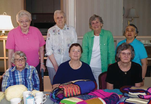 Leaside's knitting ladies led by Doreen Sherk (back row, 2nd from the right)