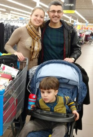 Thorncliffe Park residents Amjad Alhayak, wife Roaa & son Ward shop for winter coats. Photo by Jennifer Rajasekar.