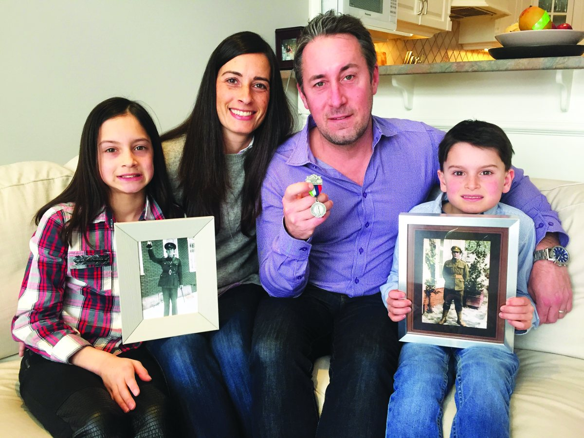 Drew and Erica Hamblin, of Sutherland Drive, with son Jack (7) holding photo of Drew's grandfather Frank Edgar Hamblin as a private in France during WWI a few months before the Battle of Vimy Ridge.Daughter Paige (10) is holding a photo of Frank Edgar Hamblin during WWII when he served in Quebec. Drew is holding a Vimy medal produced by the Vimy Foundation. The family is headed to France at the end of March to visit the battlefields and cemeteries and to participate in the centenary commemorations on April 9th. Photo By Allan Williams.