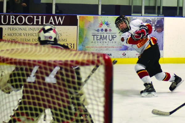 Minor Bantam Select player Nigel Vickery takes a shot at the home tournament. Photo By Gary Toporoski.
