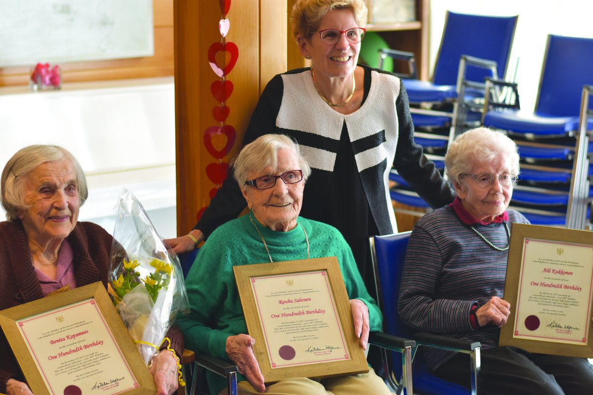 Premier Kathleen Wynne at the Suomi-Koti Seniors Centre with honourees, (l -r) Benita Kopamees, Rauha Salonen and Aili Kukkonen.