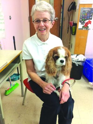 Sue Jamieson and her therapy dog Trinket visit Bessborough School
