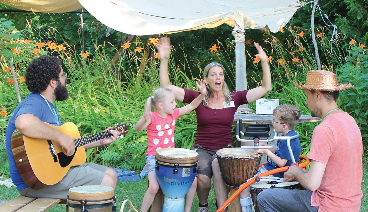 Holland Bloorview's Spiral Garden staff artists (l-r), Thiago, Lynn and Marek share the Music Circle with participants Kate and Zach.