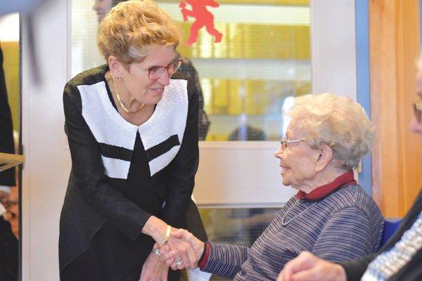 Premier Wynne congratulates Aili Kukkonen.