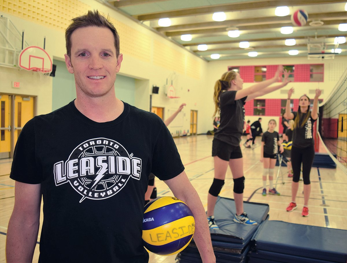 Christian Redmann and volleyball team