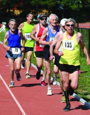 "Robert Moore leading the pack at an Ontario Masters Athletics race at the Toronto Track & Field Centre, York University. In third place is the legendary Ed Whitlock, a long-time friend of Bob Moore's, who died in March 2017. Photo by Doug ""Shaggy"" Smith."