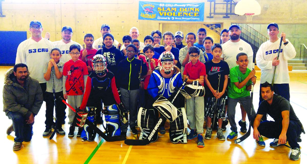 53 Division CRU members with their Thorncliffe Park ball hockey crew. Photo By Karli Vezina.