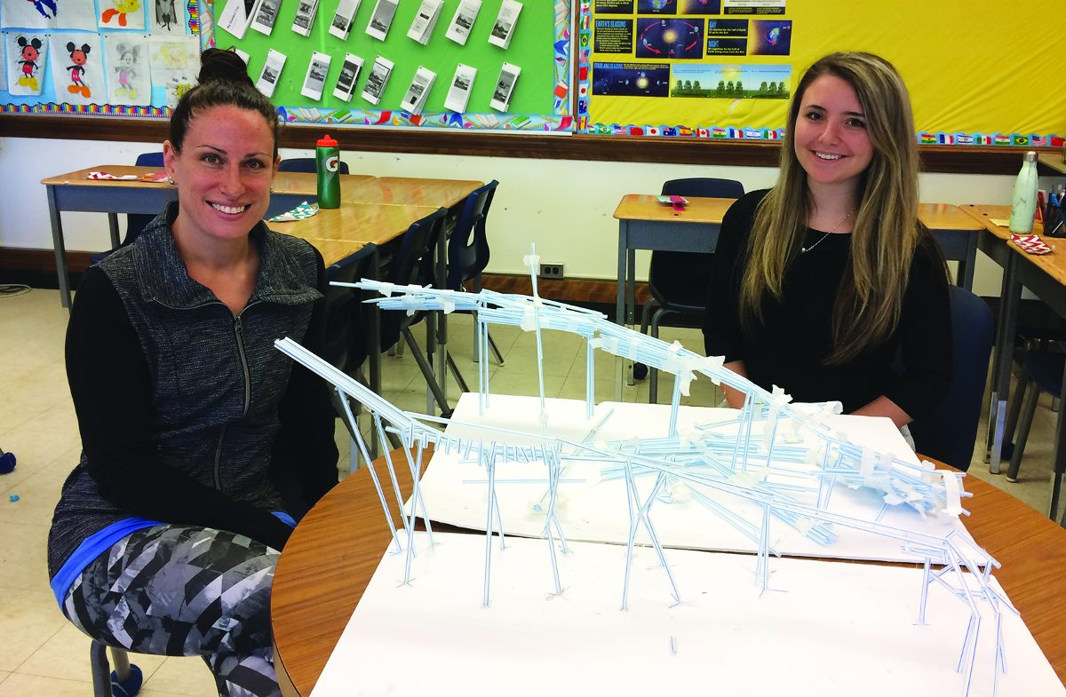 Grade 6 teacher Sarah Buksner and student teacher, Sasha Haber with a roller-coaster made out of plastic straws.