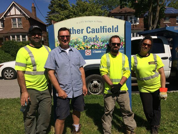 Rick Hutchings, the Community Planting and Junior Gardening Director of the Leaside Gardening Society, co-ordinates the planting of the flower beds by elementary school students with City of Toronto workers Gary Cardoso, Rick Revoredo and Ginaya Smith. The workers will maintain the gardens for the rest of the season.