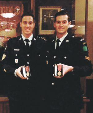 David Nespolo (right) and his best friend Michael are decorated in recognition of 12 years of military service.