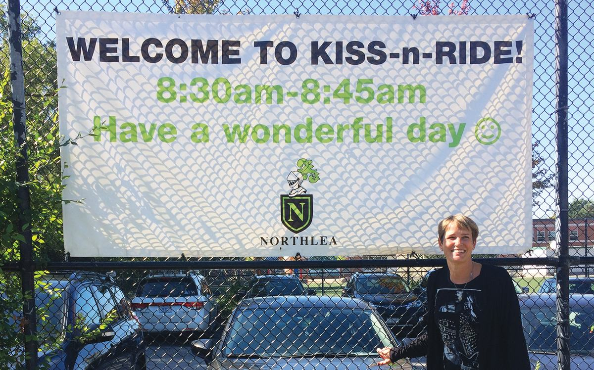Valerie Cooke and her Kiss 'n' Ride banner. Photo By Janis Fertuck.
