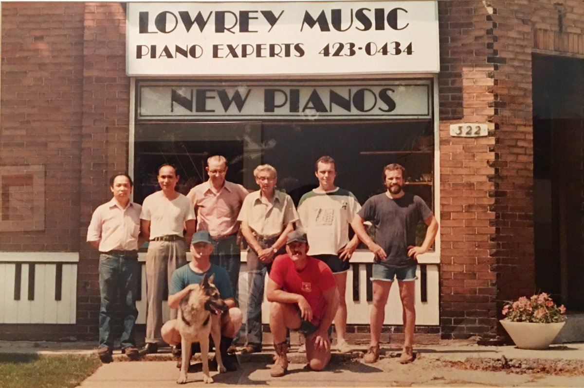 A young Robert Lowrey (far left) in front of the first location of Robert Lowrey Piano Experts at 322 Sutherland Drive.