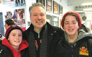Leaside AA Flames teammates Nicholas Munn and Stas Mironova (right) played against each other. Nicholas goes to Bessborough and Stas goes to Northlea. Here they pose with Nicholas's dad Jeff Munn.
