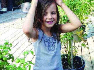 Mia with tomato