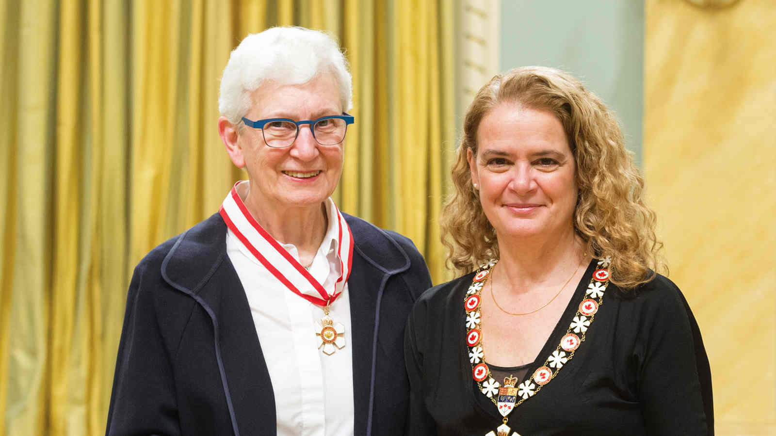 Her Excellency presents the Officer insignia of the Order of Canada to Darleen Bogart, O.C.