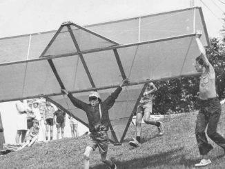 Children flying a homemade plane.