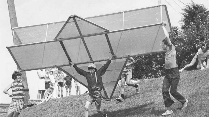 Children flying a homemade plane.