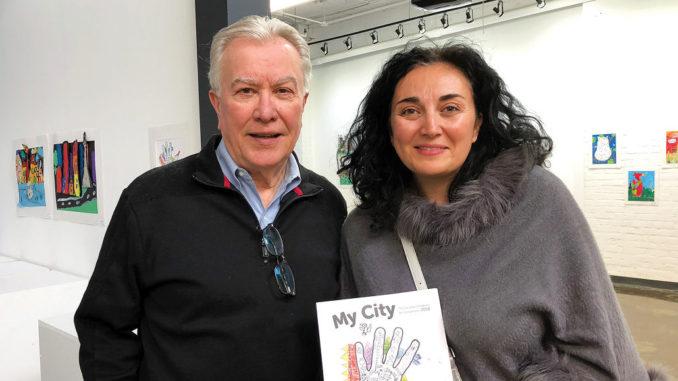 Michael Martchenko and parent Jennie Popova with the keepsake book.