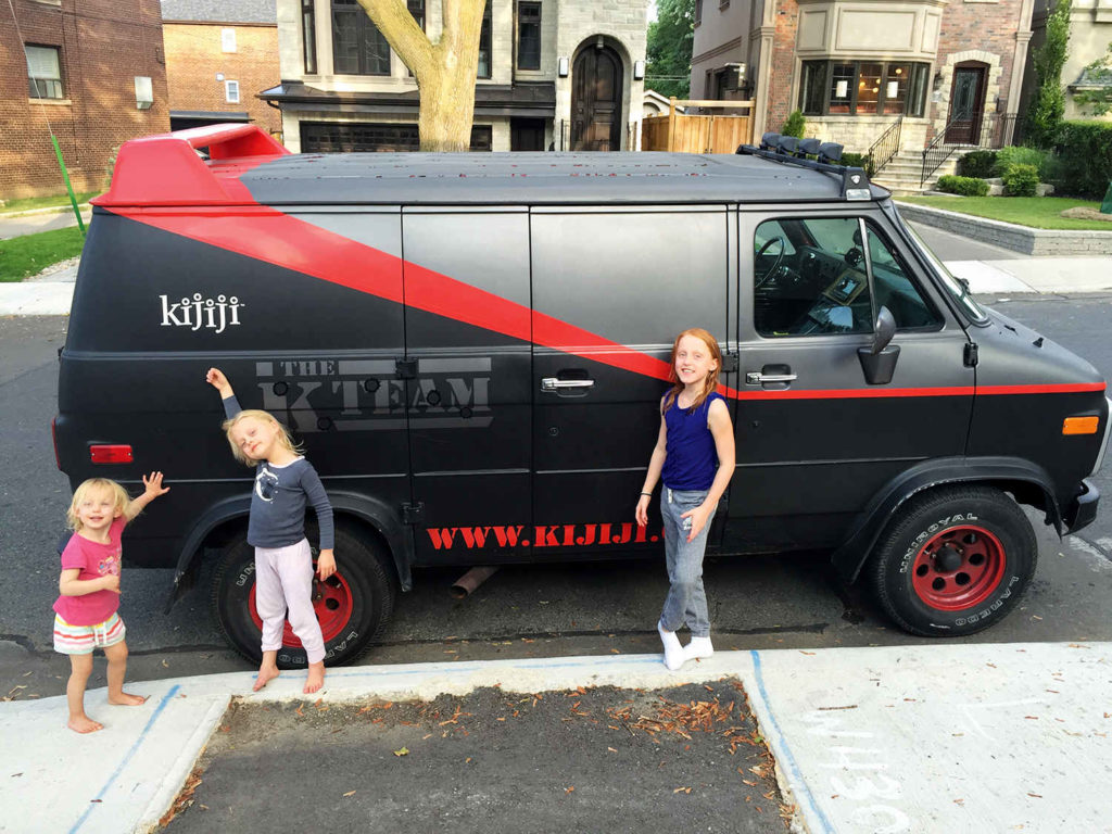 The girls in front of the Kijiji Van, a replica of the A-Team vehicle.
