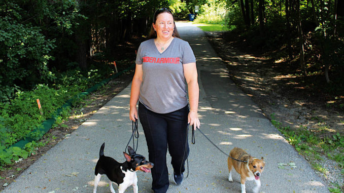 Dogwalker Alison Smith with her own dogs Baker and JD.