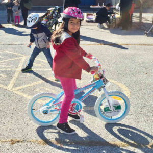 Valerie, age 8, was one of the 30 kids who received a new bike, helmet and lock.