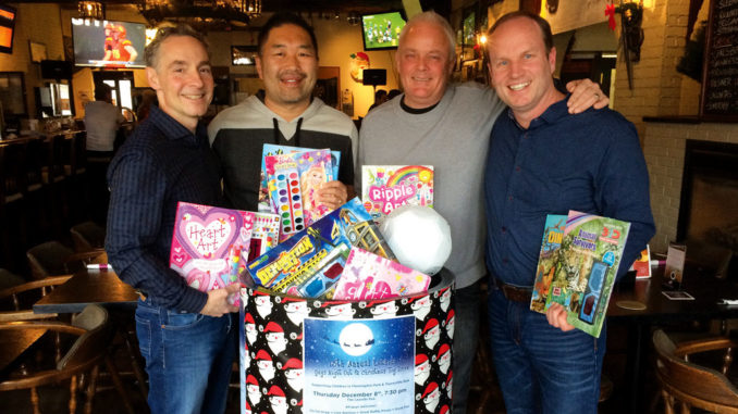 L-R: Organizers Jeff Hohner, Ed Wong, Mike Zivot and Daryn Everett with some of their loot.
