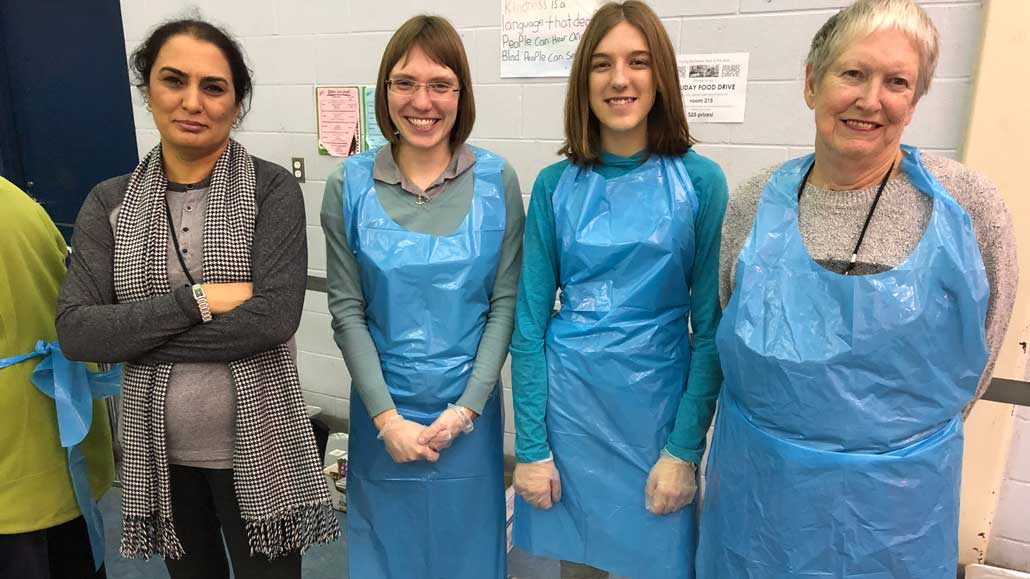 FPM's Banazir Yousofi and volunteers, Natalie Jahn, Madison O'Brien and Margaret McRae.