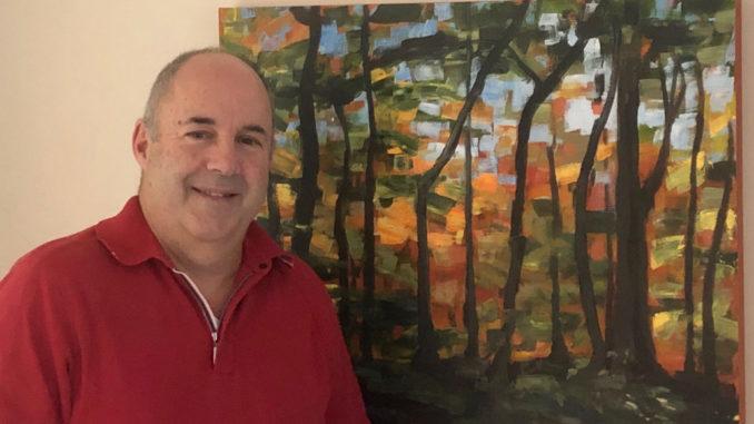 Warren with his painting Wilket Creek Ridge View.