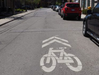 Sharrows (pictured here) indicate where cyclists should ride. For motorists, they are a reminder to share the road. Photo City of Toronto.