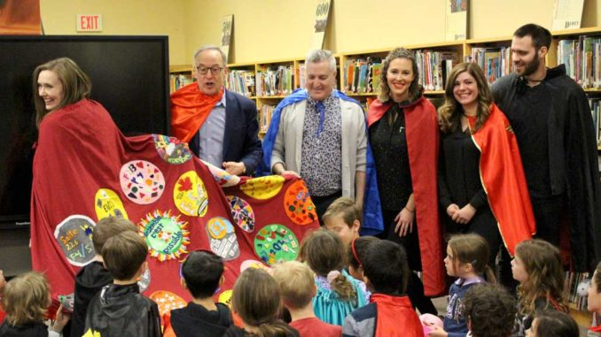 Sandra Hawken, CEO of Holland Bloorview Kids Rehabilitation Hospital, receives a cape made by the students and teachers of Northlea School.