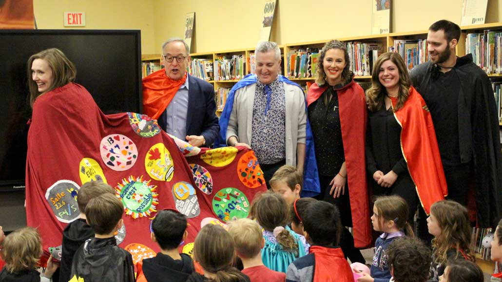 Sandra Hawken, CEO of Holland Bloorview Childrens Hospital, receives a cape made by the students and teachers of Northlea School.