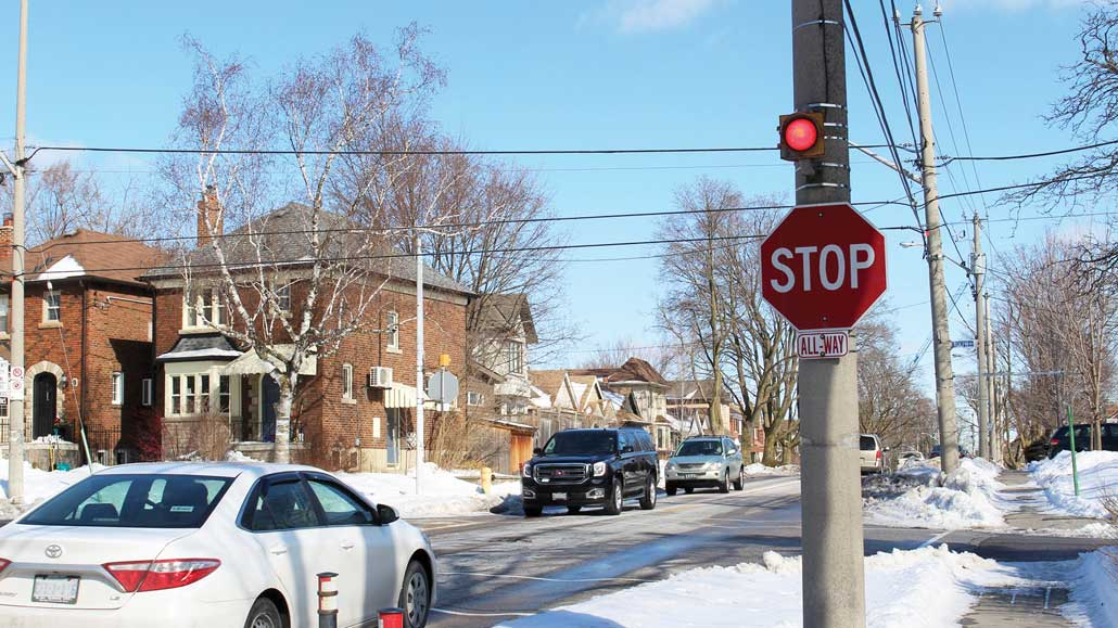 A flashing light above a stop sign in Leaside. Photo by Robin Dickie.