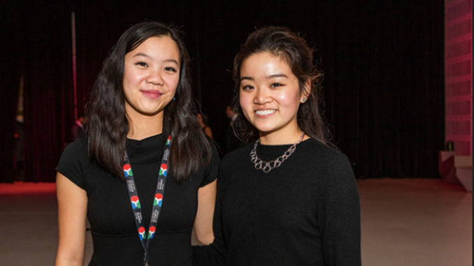 Zhen, left, with York University student volunteer Celina Cong at the Science Centre Innovators Ball.