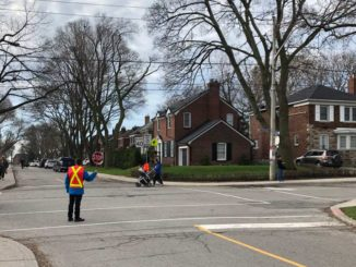 A crossing guard at Rolph Road school.