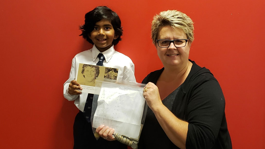 Kim from the Terry Fox Foundation gratefully accepts the cheque from Isaac. Photo Iqbal Khan.