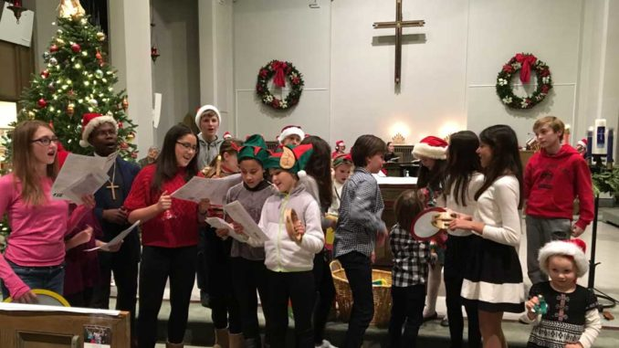 Caroling at St. Cuthbert's Anglican. Photo Kathi Davies.