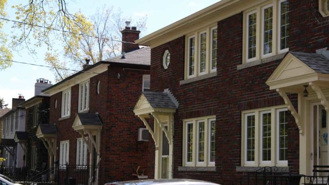 A row of traditional semi-detached homes in Leaside. Staff Photo.