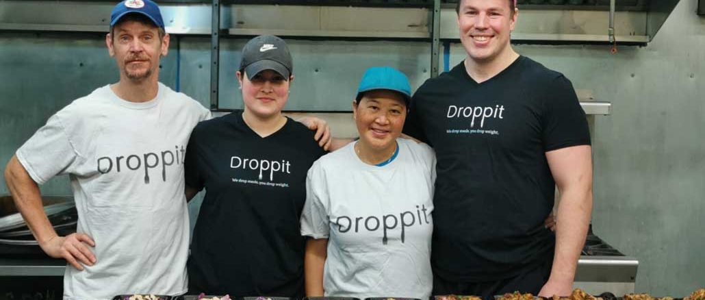 John Mangold (r) with the Droppit meal preparation team. Photo from Droppit.