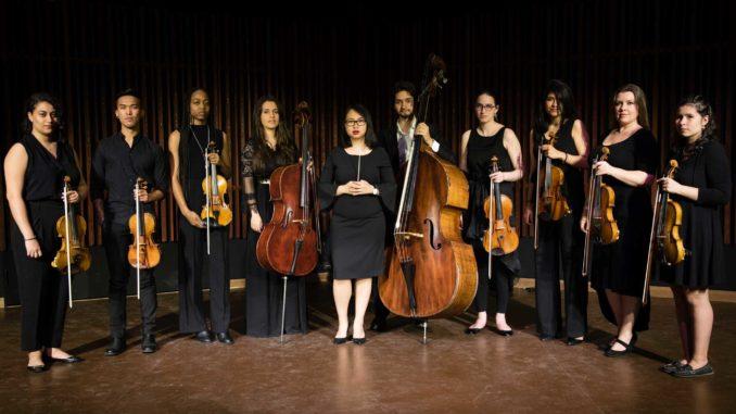 Conductor Kemi Lo (centre) and the Unitatis Strings. Photo Marissa Magneson.
