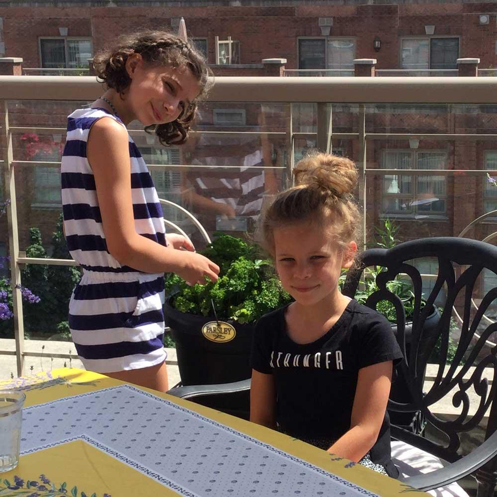 Scarlett, age 10, and Vienna on Pat's balcony.