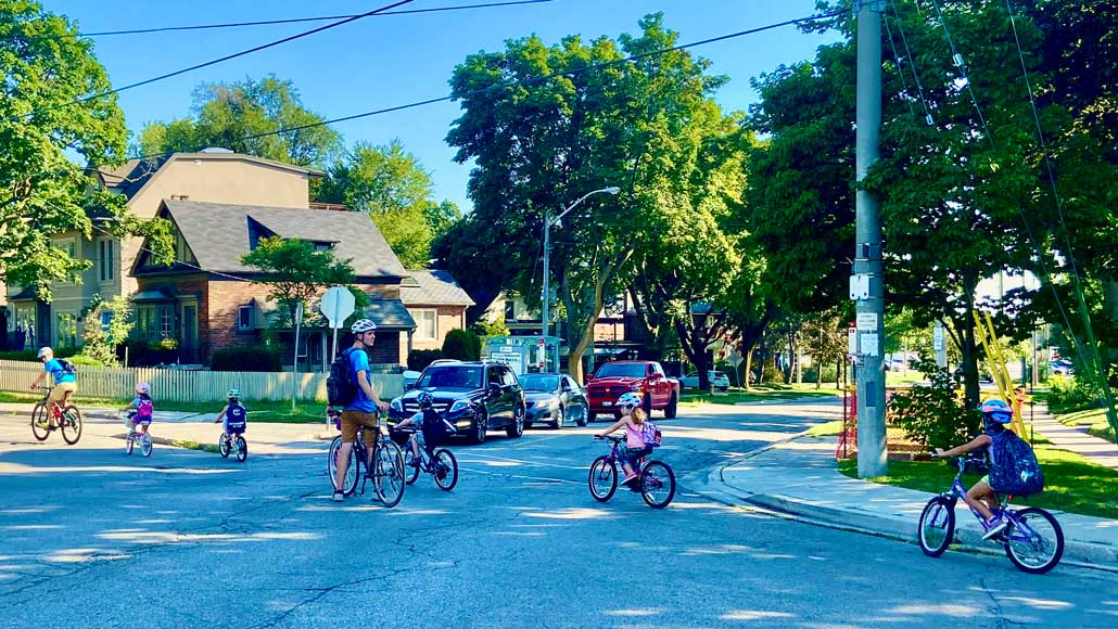 "Try a ""bike train"" like Pedalheads. A parent at each end. One parent blocks the intersections as the train rolls through. Photo by HOLLY REID."